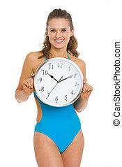 femme, horloge, projection, jeune, maillot de bain, heureux