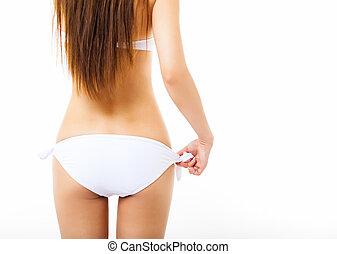femme, jeune, maillot de bain, blanc, vue postérieure