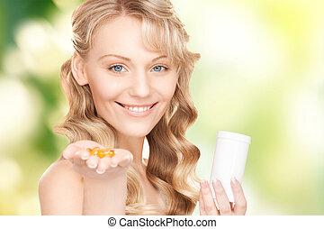 femme, jeune, pilules