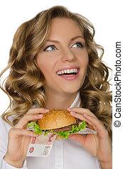 femme, jeune, rur, hamburger, regarder loin