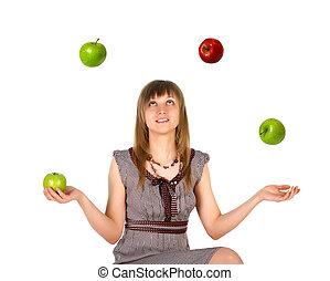 femme, jonglerie, à, pommes