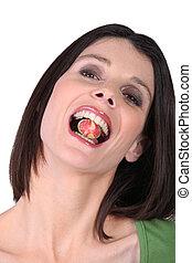 femme mange, bonbon