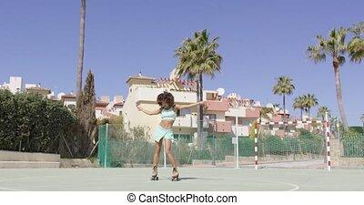 femme, patins, jeune, rouleau, danse