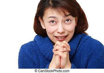 femme, plier, elle, mains dans prière