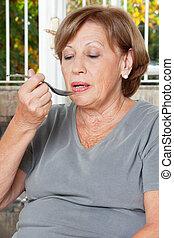 femme, prenant médicament