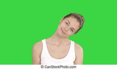 femme relâche, elle, étirage, chroma, écran, muscles, vert, key., sourire, exercice, cou