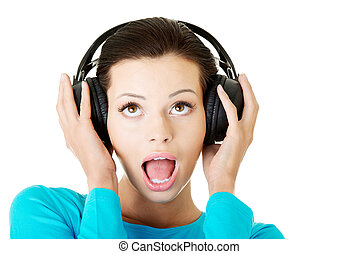 femme, séduisant, headphones.