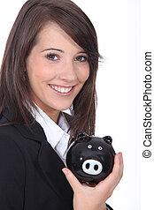 femme souriante, jeune, banque, porcin