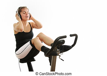 femme, sur, rotation, vélo, à, écouteurs