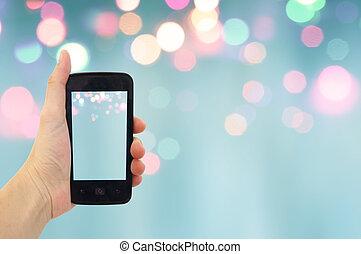 femme, téléphone, projection, isolé, brouillé, lumières, bokeh, fond, écran, abrégé main, intelligent, circulaire
