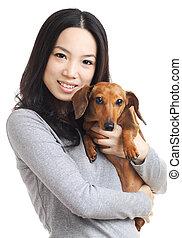 femme, teckel, asiatique, chien