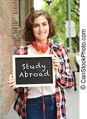 "femme, texte, tableau, tenue, ""study, abroad""."
