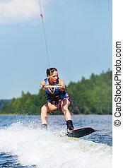 femme, wakeboard, mince, canot automobile, lac, vague, brunette, équitation