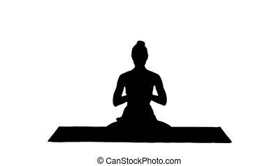 femme, yoga, décontracté, meditating., ensemble, mettre, mains, position, silhouette