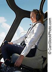 femmina, pilota, in, abitacolo, di, elicottero, durante, volo