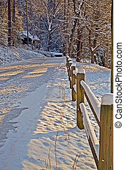 Fence Along Snow Covered Road