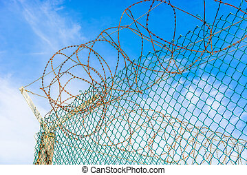 Fence and barb wires at Robben Island Prison where Nelson...