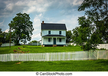Fence and old historic house at Antietam National Battlefield, Maryland.