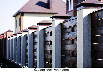 Fence and the modern house in suburban settlement