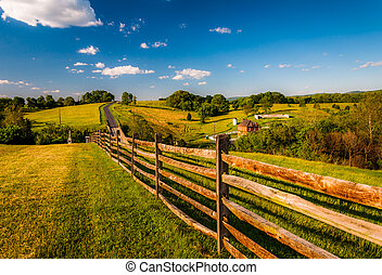 Fence and view of rolling hills and farmland in Antietam National Battlefield, Maryland (Horizontal).