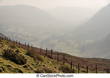 Fence besides misty valley in North Wales