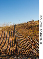 Fence by Dunes Vertical - Wood fence by sand dunes on a...