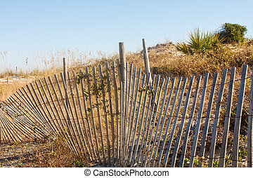 Fence by Sand Dunes on Beach