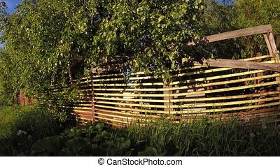 Fence cottage village - Dynamic panorama of a fence in a...