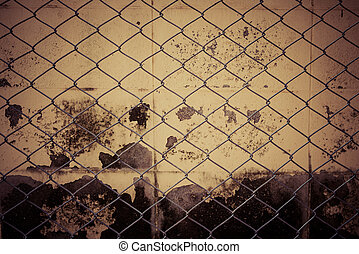 Fence from steel mesh on grunge cement wall backgroud with vintage filter