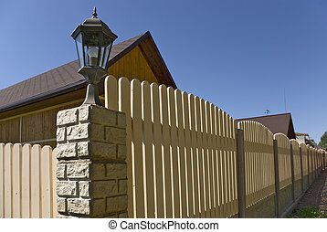 Fence near new houses. - Suburb of small small town in the...