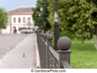 Fence of iron in the alley city