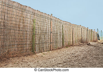 fence of reed in the beach