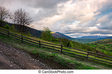 fence on a hillside of mountainous countryside. lovely rural...