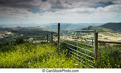 Fence on a hilly landscape