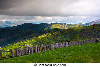 fence on the edge of the hillside. beautiful rural landscape...