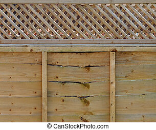 Decorative wooden fence panel with trellis top