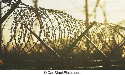 fence prison strict regime the silhouette barbed wire....