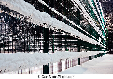 fence under the snow in winter park