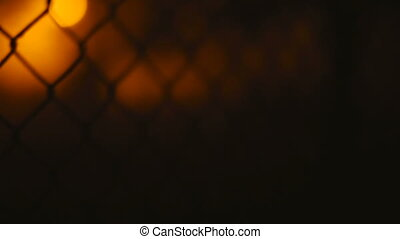 Fence wire mesh at night. - Fence wire mesh at night close...