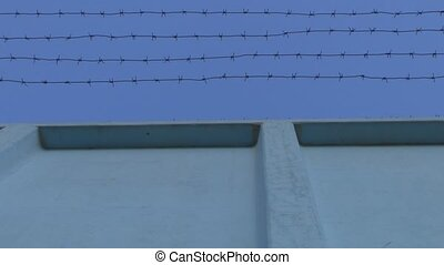Fence with barbed wire