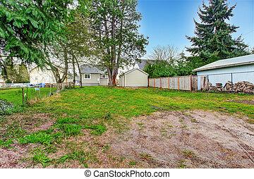 Fenced backyard view