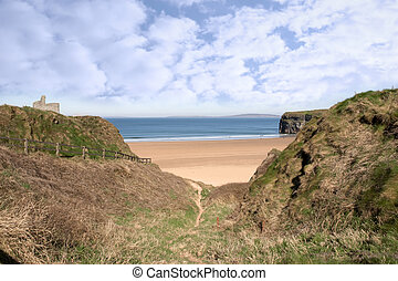 fenced path to Ballybunion castle and beach