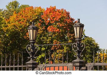 Fencing of autumn park