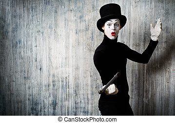 fencing - Elegant expressive male mime artist posing with...