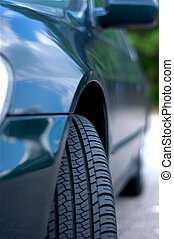 Fender reflections. - Front tire of a car with the clouds ...