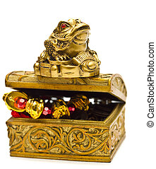 Feng Shui frog on golden chest