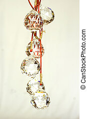 cut glass feng shui balls on a neutral background