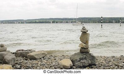 feng shui stone sculpture with sailing ship at lake Bodensee...