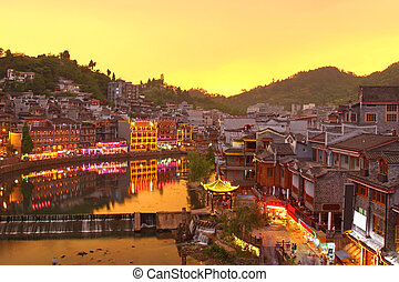 Fenghuang ancient town in Hunan Province at sunset time