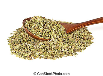 Fennel seeds in wooden spoon over white background